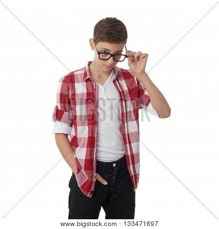 Cute teenager boy in red checkered shirt and glasses over white isolated background, half body