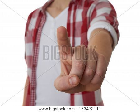 Cute teenager boy in red checkered shirt pushing something with finger over white isolated background, half body