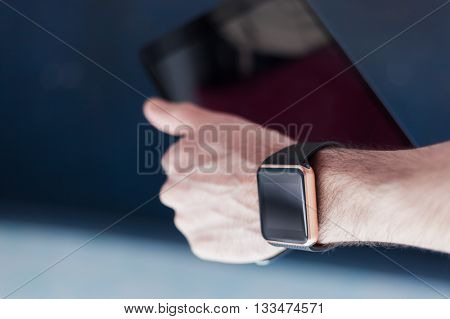 Smart Watch And Tablet Pc In A Hand
