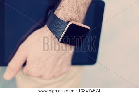 Smart Watch On Hand And Tablet Pc In Hand