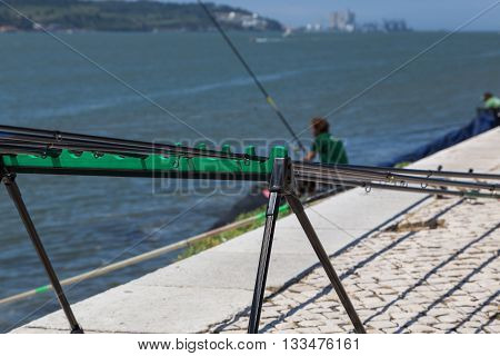 Fishing Stand With Angling Rods On Promenade