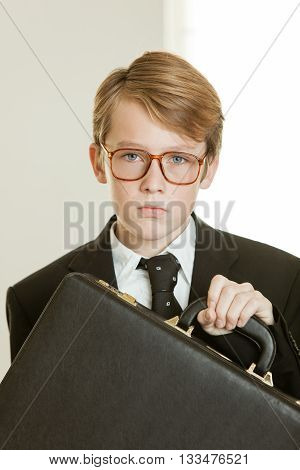 Serious Boy In Business Suit And Brief Case