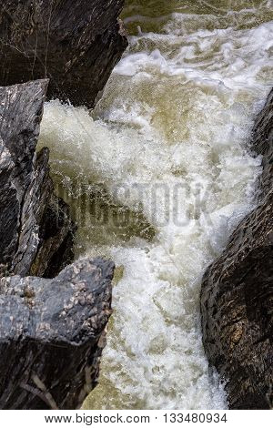 Waterfall Flowing Between The Lava Stones