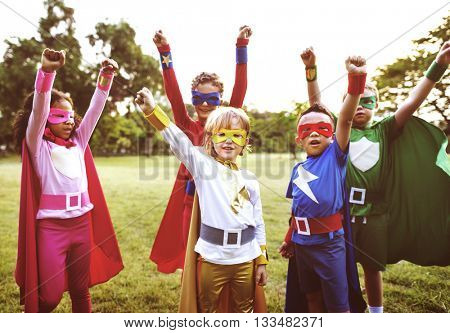 Superheroes Kids Friends Playing Togetherness Concept, soft focus