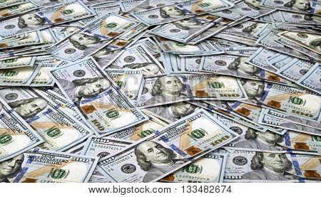 Table full of new hundred dollar bills .
