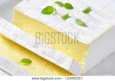 sliced soft cheese with white rind - detail