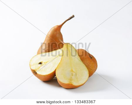 ripe bosc pears on white background