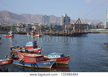 ANTOFAGASTA, CHILE - MAY 16, 2016: Colourful fishing boats in the harbour of Antofagasta on the Pacific coast of Chile.