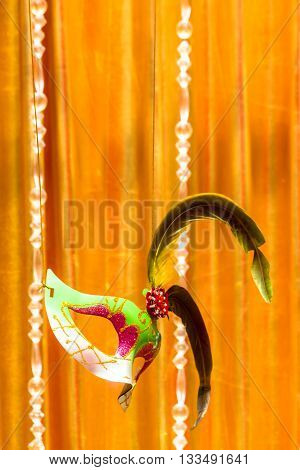 Mask floating on stage and gold curtain background and copy space.