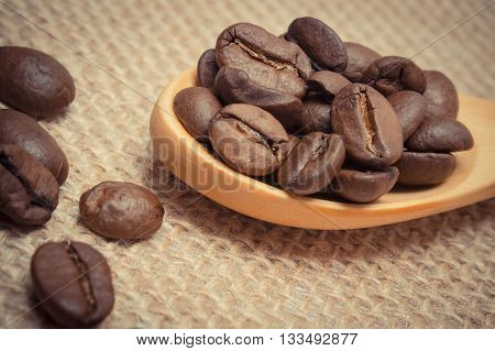 Vintage Photo, Heap Of Coffee Beans With Wooden Spoon On Jute Canvas