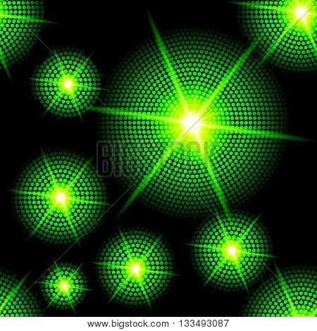 Abstract sparkling background with green starburst in the dark