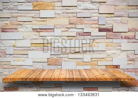 Empty wooden shelves and stone wall background. For display or montage your products.