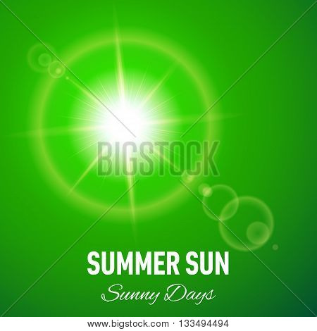 Green summer background with glaring sun and lens flare
