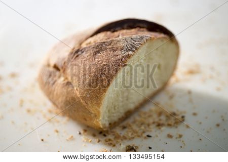 piece of bread cut with crumbs