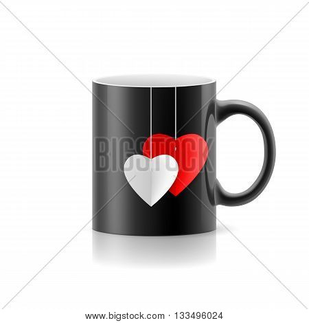 Black cup with teabag stay on white background