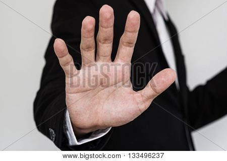 Businessman showing palm hand, Close up hand