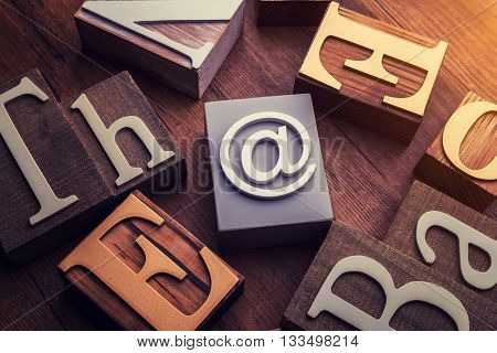 concept word forming with cube on wooden E-mail symbol