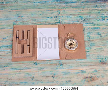 compass on the note book on table