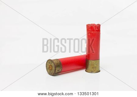 Red shotgun shell used.On white background .