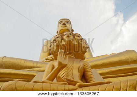 Eight head buddha under big golden buddha meditating