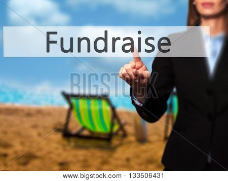 Fundraise - Businesswoman Hand Pressing Button On Touch Screen Interface.