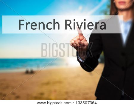 French Riviera - Businesswoman Hand Pressing Button On Touch Screen Interface.
