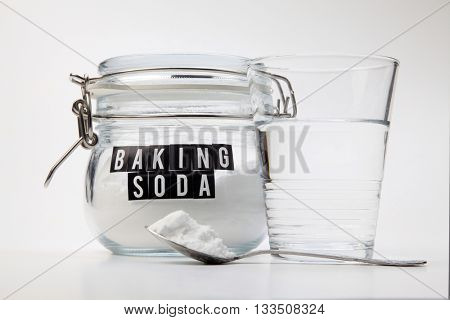 Spoonful of baking soda and glass of water