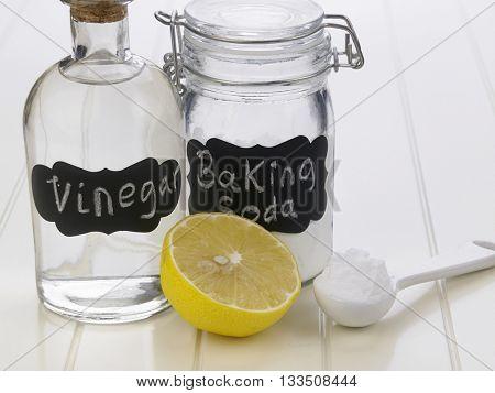 baking soda vinegar and lemon on the white background