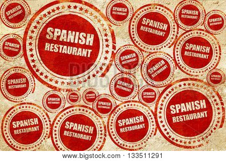 Delicious spanish cuisine, red stamp on a grunge paper texture
