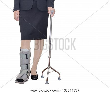Businesswoman's leg with brace over white background