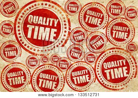 quality time, red stamp on a grunge paper texture