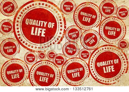 quality of life, red stamp on a grunge paper texture