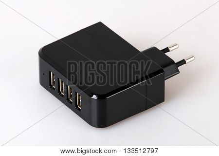 Multiple charger for smart phones on grey background