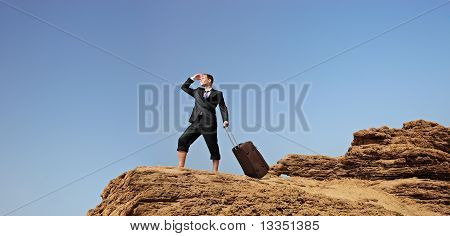 Lost Businessman With A Suitcase Searching For A Way