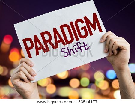 Paradigm Shift placard with night lights on background