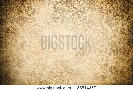 Aging paper background with old-fashioned floral patterns. Vintage paper texture for the design..