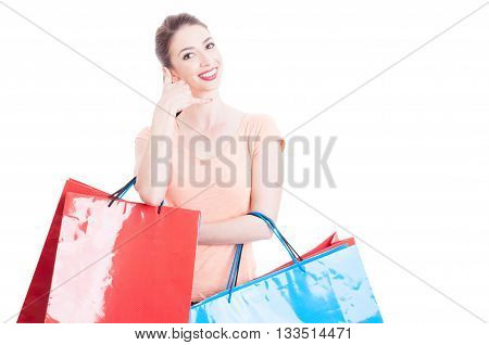 Smiling Lady Holding Shopping Bags Making Call Me Gesture