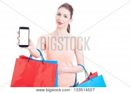 Woman Carrying Bunch Of Gift Shopping Bags Showing Blank Cellphone