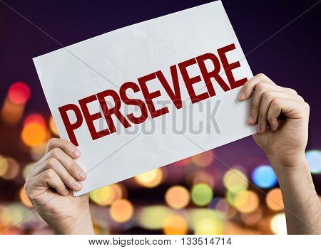 Persevere placard with night lights on background