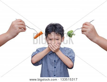 Young Asian boy close his mouth by hand because don't want to eat vegetables