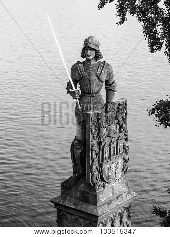 Knight Bruncvik, or Brunclik, statue on Charles bridge in Prague, Czech Republic. . Black and white image.