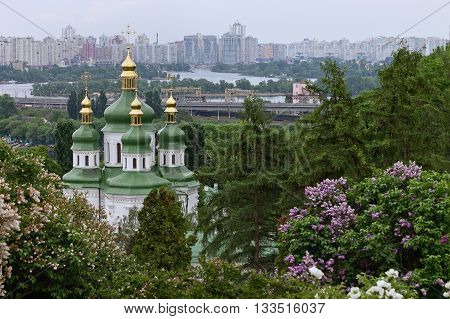 urban landscape with a blooming garden and the Vydubychi Monastery in Kiev Ukraine