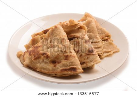 Traditional Indian Alu Paratha in a white plate