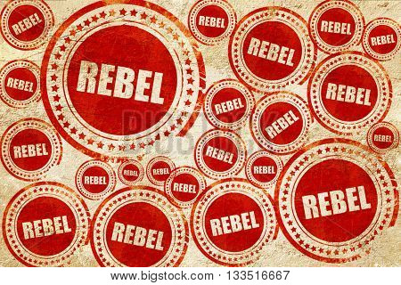 rebel, red stamp on a grunge paper texture