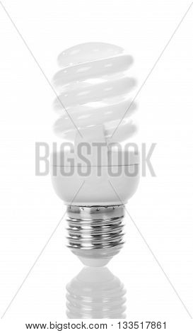 Compact fluorescent light bulb close up isolated on white background.