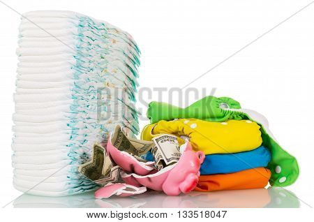 Disposable diapers and tissue, broken piggy bank, money isolated on a white background.