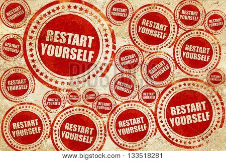 restart yourself, red stamp on a grunge paper texture