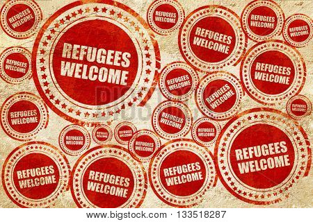 refugees welcome, red stamp on a grunge paper texture