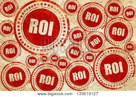 roi, red stamp on a grunge paper texture
