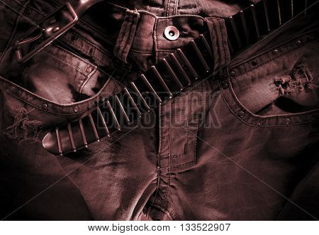 WEATHERED JEANS  WITH OPEN BELT , CROTCH CLOSEUP , DARK ARTISTIC PHOTOGRAPHY WITH INTENSE HIGHLIGHTS
